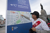 YEKATERINBURG, RUSSIA - June 21, 2018: A Peru fan looks at directions to the  stadium before their game against France in their 2018 FIFA World Cup group stage at Yekaterinburg Arena Stadium.