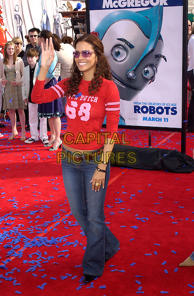"HALLE BERRY.The Twentieth Century Fox's Los Angeles Premiere of ""Robots"" held at The Mann Village Theatre in Westwood, California .March 6th, 2005.full length sunglasses shades von dutch red top waving gesture jeans denim.www.capitalpictures.com.sales@capitalpictures.com.Supplied By Capital PIctures"