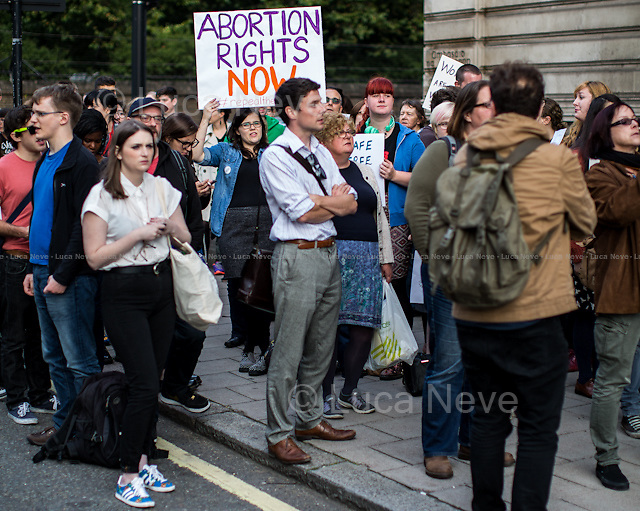 London, 20/08/2014. Today, a demonstration organised by &quot;Abortion Rights East London&quot; was held outside the Irish embassy in London, simultaneously with a pro-choice demonstration held in Dublin. The aim of the protest was (from the organisers' online press release): &lt;&lt;to demonstrate against the Irish government's horrendous treatment of a young woman, pregnant as a consequence of rape, who was suicidal and refused a lawful abortion under the Protection of Life in Pregnancy Act 2014. We think this is barbaric. We're meeting at 6pm outside the Irish Embassy to protest the gross violence and injustice visited upon the unnamed woman, and to call for Ireland to repeal the 8th amendment, which bans abortion&gt;&gt;. <br />