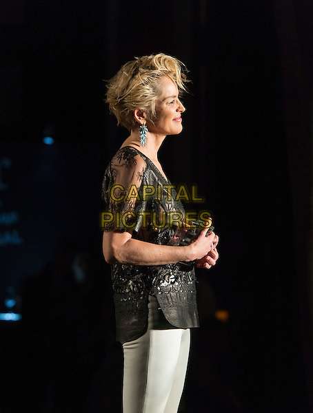 MIAMI - November 06: Sharon Stone stands back admiring her sister Kelly Stone after presenting her with the Legacy Award of Excellence for her 20 plus years of help with the homeless and Planet Hope. The event was held at the Setai Hotel in Miami Beach as part of Funkshion Fashion Week. November 6, 2015. <br /> CAP/MPI/BSAP<br /> &copy;BSAP/MPI/Capital Pictures