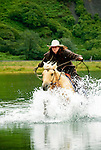 Rochelle riding across the Pasagshak River. Kodiak Island, Alaska