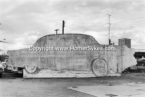 Old wooden cut out advertising board for a car. Gallup New Mexico USA 1971.