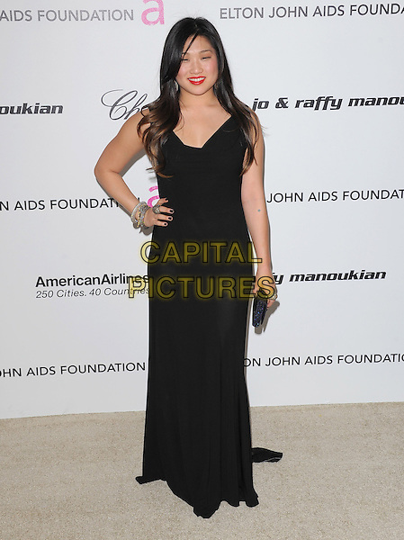 JENNA USHKOWITZ .at the 19th Annual Elton John AIDS Foundation Academy Awards Viewing Party held at The Pacific Design Center Outdoor Plaza in West Hollywood, California, USA, February 27th 2011..oscars full length black dress hand on hip long maxi clutch bag  .CAP/RKE/DVS.©DVS/RockinExposures/Capital Pictures.
