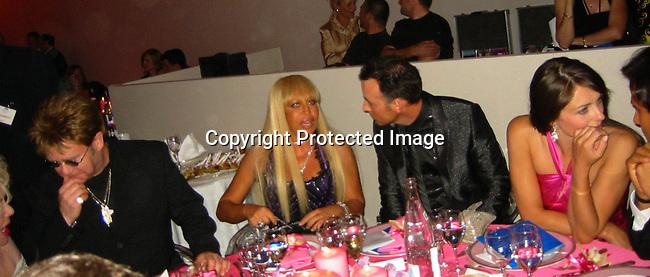 Elizabeth Taylor, Elton John, Donnatella Versace, David & Elizabeth Hurley.**EXCLUSIVE**.2003 amFAR Cinema Against Aids-Cannes Film Festival.Moulin de Mougins.Thursday, May 22, 2003.Mougins, France.Photo By Celebrityvibe.com/Photovibe.com