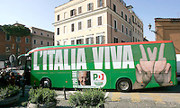 "Il pullman del Partito Democratico, che accompagnera' il leader e candidato premier Walter Veltroni nel suo tour elettorale in giro per l'Italia, arriva davanti alla sede del partito a Roma, 15 febbraio 2008..The Democratic Party's electoral campaign bus arrives in front of the party's headquarters in Rome, 15 february 2008. Writing on the bus reads: ""Italy Alive"" as a play on words on ""Viva L'Italia"" (Long Live Italy). At bottom, a picture portraying party's leader and candidate premier Walter Veltroni, who will cover by the bus the Italian territory for his electoral tour. Political elections are scheduled on next 13 and 14 april..UPDATE IMAGES PRESS/Riccardo De Luca"