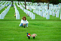 Woman sitting thoughtfully at Fort Snelling Cemetery age 25.  Minneapolis Minnesota USA