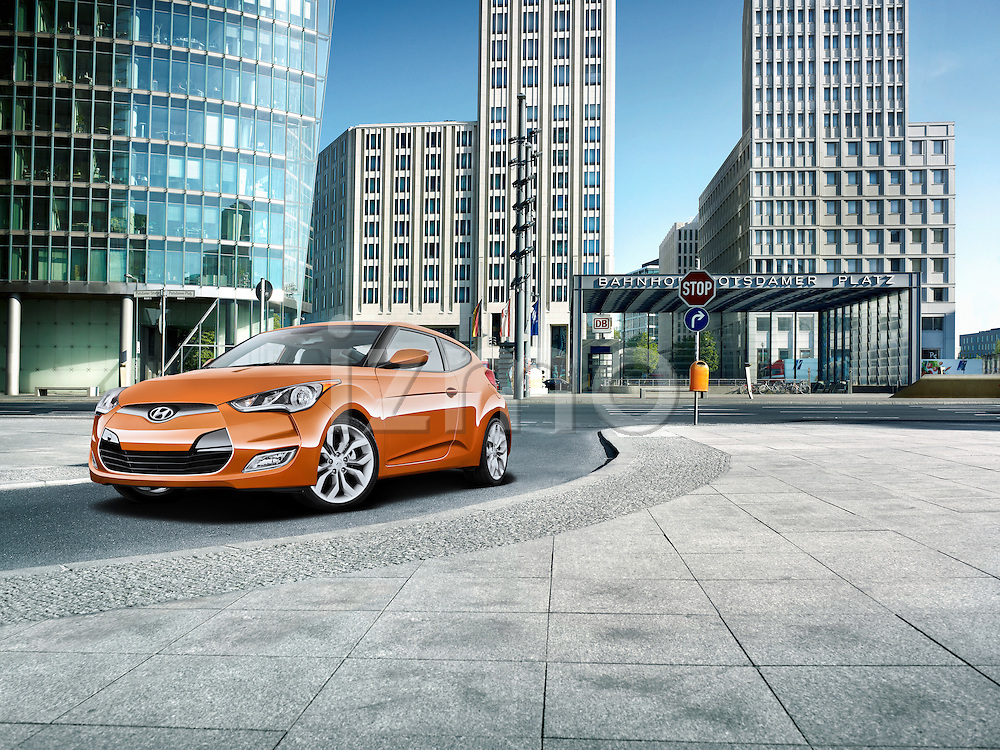 One orange 2012 Hyundai Veloster driving on a city street in Berlin, Germany.