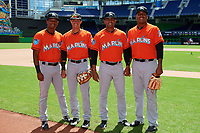 Miami Marlins Brayan Hernandez (23), Jorge Caballero (13), Manny Rodriguez (66) and Alberto Guerrero (26) during a Florida Instructional League game against the Washington Nationals on September 26, 2018 at the Marlins Park in Miami, Florida.  (Mike Janes/Four Seam Images)