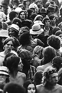 "Watkins Glen, NY. July 28th, 1973. <br /> Couple kissing in the middle of the crowd.<br /> The Summer Jam at Watkins Glen was a 1973 rock festival which once received the Guinness Book of World Records entry for ""Largest audience at a pop festival."" An estimated 600,000 rock fans came to the Watkins Glen Grand Prix Raceway outside of Watkins Glen, New York on July 28, 1973, to see The Allman Brothers Band, Grateful Dead and The Band perform.<br /> Similar to the 1969 Woodstock Festival, an enormous traffic jam created chaos for those who attempted to make it to the concert site. Long and narrow country roads forced fans to abandon their vehicles and walk 5–8 miles on that hot summer day. 150,000 tickets were sold for $10 each, but for all the other people it was a free concert. The crowd was so huge that a large part of the audience was not able to see the stage; however, twelve huge sound amplifiers, installed courtesy of legendary promoter Bill Graham, allowed the audience to at least hear."