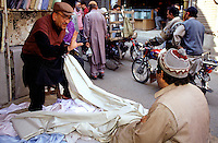 A cloth dealer at the Kashmiri Bazaar in the old town of Lahore.<br /> 15.2.2001, Lahore/Pakistan<br /> Copyright: Christian-Ditsch.de<br /> [Inhaltsveraendernde Manipulation des Fotos nur nach ausdruecklicher Genehmigung des Fotografen. Vereinbarungen ueber Abtretung von Persoenlichkeitsrechten/Model Release der abgebildeten Person/Personen liegen nicht vor. NO MODEL RELEASE! Nur fuer Redaktionelle Zwecke. Don't publish without copyright Christian-Ditsch.de, Veroeffentlichung nur mit Fotografennennung, sowie gegen Honorar, MwSt. und Beleg. Konto: I N G - D i B a, IBAN DE58500105175400192269, BIC INGDDEFFXXX, Kontakt: post@christian-ditsch.de<br /> Bei der Bearbeitung der Dateiinformationen darf die Urheberkennzeichnung in den EXIF- und  IPTC-Daten nicht entfernt werden, diese sind in digitalen Medien nach §95c UrhG rechtlich geschuetzt. Der Urhebervermerk wird gemaess §13 UrhG verlangt.]