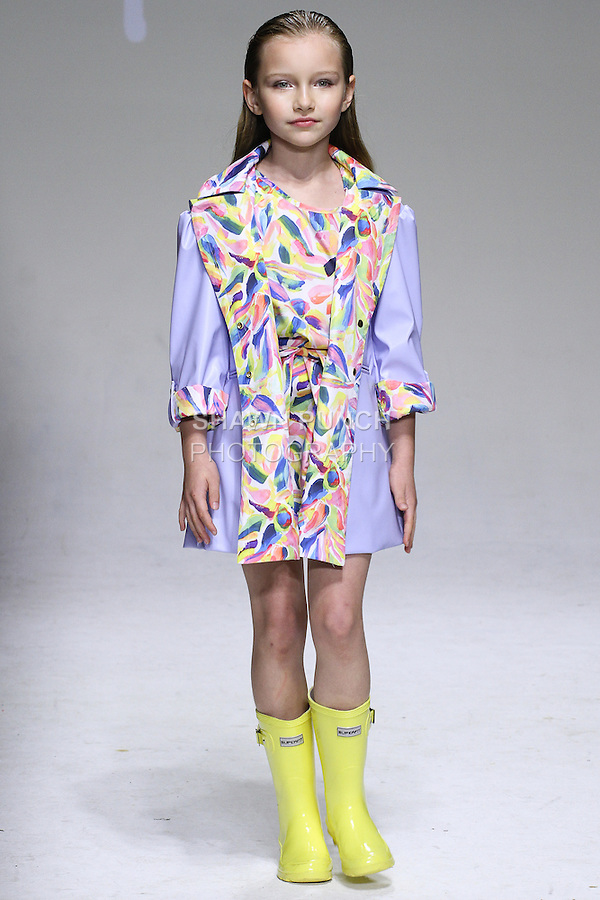 Young model walks runway in an outfit from the Oil & Water Spring 2015 collection by Amy Wismar, at petitePARADE Spring Summer 2015, during Kids Fashion Week in New York City, on October 19, 2014.
