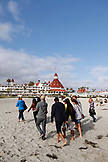 USA, California, San Diego, USA, California, San Diego, family gathers on the beach in front of Hotel Del Coronado