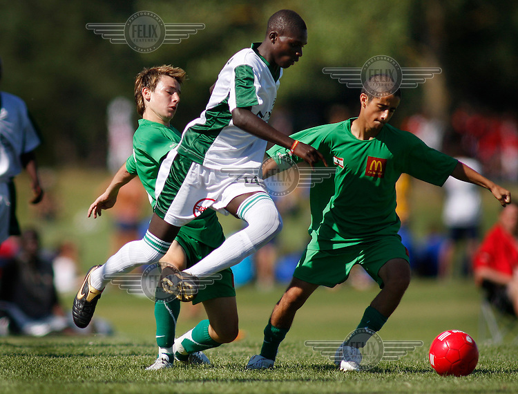 A player from Kenyan team Mathare UTD battles two players from Al-Shabab of Lebanon.Norway Cup is the worlds largest football tournament, in 2008 bringing together 30.000 children from all over the world, aged 10 to 19. They make up 1386 teams playing a total of 4400 matches during the week they play. The tournament is played on a big grass field just outside the center of Oslo, Norway.