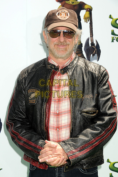 "STEVEN SPIELBERG.Attending the ""Shrek Forever After"" Los Angeles Film Premiere held at the Gibson Amphitheatre, Universal City, California, USA, 16th May 2010..arrivals half length cap hat sunglasses black leather jacket red plaid shirt beard facial hair .CAP/ADM/BP.©Byron Purvis/AdMedia/Capital Pictures."