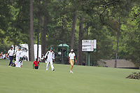 Francesco Molinari (ITA) Tiger Woods (USA) Tony Finau (USA) on the 13th fairway during the final round at the The Masters , Augusta National, Augusta, Georgia, USA. 14/04/2019.<br /> Picture Fran Caffrey / Golffile.ie<br /> <br /> All photo usage must carry mandatory copyright credit (© Golffile | Fran Caffrey)