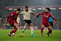 Manchester United's Anthony Martial shields the ball from Liverpool's Mohamed Salah and Trent Alexander-Arnold<br /> <br /> Photographer Alex Dodd/CameraSport<br /> <br /> The Premier League - Liverpool v Manchester United - Sunday 19th January 2020 - Anfield - Liverpool<br /> <br /> World Copyright © 2020 CameraSport. All rights reserved. 43 Linden Ave. Countesthorpe. Leicester. England. LE8 5PG - Tel: +44 (0) 116 277 4147 - admin@camerasport.com - www.camerasport.com