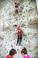 Switzerland. Canton Ticino. Tenero. Centro Sportivo Nazionale della Gioventù - Tenero (CST). Nationales Jugendsportzentrum Tenero. Athletes from various swiss teams are building up team spirit while training on a climbing wall. A climbing wall is an artificially constructed wall with grips for hands and feet, usually used for indoor climbing, but sometimes located outdoors as well. The material used is a thick multiplex board with holes drilled into it. The wall may have places to attach belay ropes, but may also be used to practice lead climbing or bouldering.01.06.11 © 2011 Didier Ruef