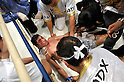Jorge Solis (MEX),..DECEMBER 31, 2011 - Boxing :..Jorge Solis of Mexico receives treatment on the ring after being knocked out in the eleventh round during the WBA super featherweight title bout at Yokohama Cultural Gymnasium in Kanagawa, Japan. (Photo by Hiroaki Yamaguchi/AFLO)