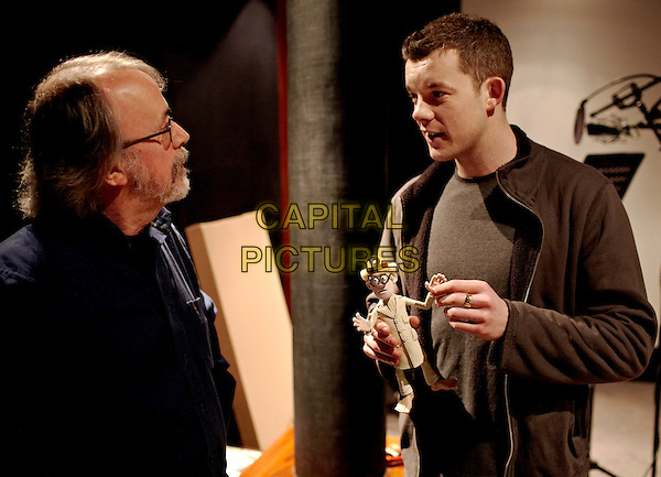 Peter Lord (director) works with Russell Tovey, seen here with the puppet for his Albino Pirate character -- presently in disguise as a scientist -- during voiceover sessions .behind the scenes in The Pirates! In an Adventure with Scientists (The Pirates! Band of Misfits).*Filmstill - Editorial Use Only*.CAP/NFS.Supplied by Capital Pictures.