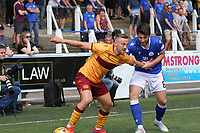 Lewis Kidd being fended off by Allan Campbell in the SPFL Betfred League Cup group match between Queen of the South and Motherwell at Palmerston Park, Dumfries on 13.7.19.