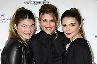 ***FILE PHOTO*** Lori Loughlin and husband, Mossimo Giannulli, will plead guilty to conspiracy charges in connection with securing  fraudulent admission of their two daughters.<br /> <br /> LOS ANGELES, CA - NOVEMBER 4: Lori Loughlin, Isabella Rose Giannulli, Olivia Jade Giannulli at the Hallmark Channel's Northpole Screening Reception at La Piazza Restaurant in Los Angeles, CA on November 4, 2014. <br /> CAP/MPI/DE<br /> ©DE//MPI/Capital Pictures