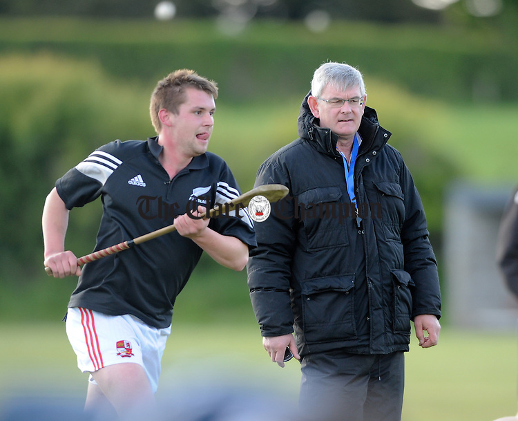 Crusheen manager Michael Browne during his team's warm-up before their Clare Champion Cup game against Sixmilebridge at Crusheen. Photograph by John Kelly.