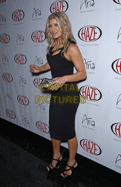 FERGIE (STACEY FERGUSON) of Black Eyed Peas .Fergie hosts the night at Haze Nightclub at Aria Resort and Casino, Las Vegas, Nevada, USA, 20th May 2011..full length black cut out cleavage dress side mouth open funny   open toe shoes clutch bag .CAP/ADM/MJT.© MJT/AdMedia/Capital Pictures.