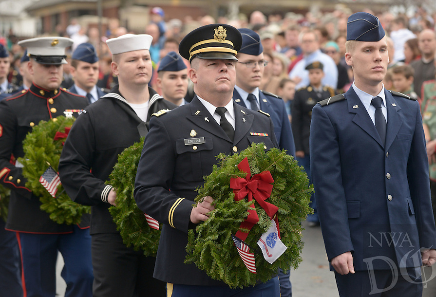 NWA Democrat-Gazette/BEN GOFF @NWABENGOFF<br /> Members of the armed forces take part in the opening procession on Saturday Dec. 12, 2015 during the Wreaths Across America ceremony at Fayetteville National Cemetery. Family members and volunteers with various veterans and community groups helped place a balsam remembrance wreath on the grave of each veteran at the cemetery as part of National Wreaths Across America Day.