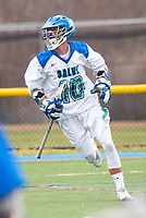 Nick LoCicero,'17, charges for the goal as the Seahawks battle Roger Williams in Men's Lacrosse game action at Gaudet Field in Middletown.
