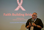 """Monsignor Robert J Vitillo, general secretary of the International Catholic Migration Commission, speaks during a July 22 session of """"Faith Building Bridges"""" in Amsterdam, the Netherlands. The July 21-22 interfaith event, sponsored by the World Council of Churches-Ecumenical Advocacy Alliance, was held on the eve of the 2018 International AIDS Conference."""