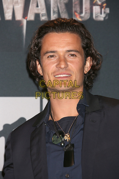 LOS ANGELES, CA - APRIL 13: Orlando Bloom in the press room at the 2014 MTV Movie Awards at Nokia Theatre L.A. Live on April 13, 2014 in Los Angeles, California. <br /> CAP/MPI/JO<br /> &copy;Janice Ogata/MPI/Capital Pictures