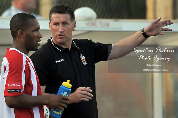 Jim McFarlane (Hornchurch Manager) gives instructions to goalscorer Rickie Hayles (Hornchurch). AFC Hornchurch Vs Wingate and Finchley. Ryman Premier League. The Stadium. Essex. 01/10/2011. MANDATORY Credit Sportinpictures/Garry Bowden - NO UNAUTHORISED USE - 07837 394578