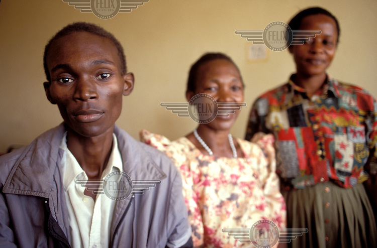 Aids patient with mother and social worker, Kampala, Uganda...© Crispin Hughes/Panos Pictures
