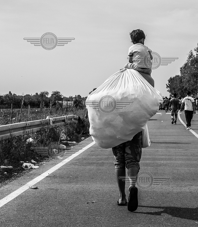 Refugees walk towards the Croatian border after Hungary closed its border with Serbia.