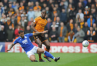 Wolverhampton Wanderers' Willy Boly is tackled by Birmingham City's David Davis<br /> <br /> Photographer Ashley Crowden/CameraSport<br /> <br /> The EFL Sky Bet Championship - Wolverhampton Wanderers v Birmingham City - Sunday 15th April 2018 - Molineux - Wolverhampton<br /> <br /> World Copyright &copy; 2018 CameraSport. All rights reserved. 43 Linden Ave. Countesthorpe. Leicester. England. LE8 5PG - Tel: +44 (0) 116 277 4147 - admin@camerasport.com - www.camerasport.com