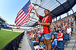 Avery Kassman, 10 from Wichita, Kansas waves an American flag as the USA team is introduced prior to their game against Japan, the second of two Tournament of Nations games at Children's Mercy Park in Kansas City, Kansas on July 26, 2018.<br /> Photo by Tim Vizer