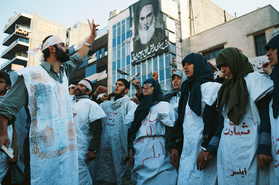 TEHRAN, IRAN - 1979: A demonstration by the supporters of the religious leader of the 1979 Iranian revolution; Ruhollah Musavi Khomeini. The white fabric over their clothes are symbols of the Islamic Burial Shroud to show their great support towards Khomeini and the fact that they are ready for martyrdom in the name of Islam. (Photo by Reza/Webistan)<br />