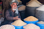 Portrait of an Afghan man selling grain in Kabul Bazar