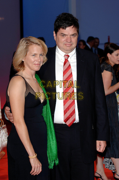 "OLIVER PLATT & HIS WIFE.Arrivals at screening of ""Casanova"".62nd International Film Festival,.Venice, 3rd September 2005.half length La Biennale black suit dress green scarf red srtipe tie couple husband .Ref: PL.www.capitalpictures.com.sales@capitalpictures.com.©Capital Pictures."