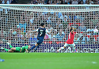 August 09, 2012: United States goalkeeper Hope Solo and defender Shannon Boxx scramble to save as Japan's Shinobu Ohno fails to convert during Women's Football Final match at the Wembley Stadium on day thirteen in Wembley, England. USA defeat Japan 2-1 to win it's third consecutive Olympic gold medal in women's soccer. ..