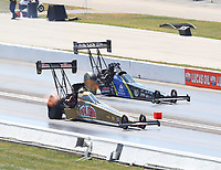 Sep 3, 2017; Clermont, IN, USA; NHRA top fuel driver Leah Pritchett (near) races alongside Ashley Sanford during qualifying for the US Nationals at Lucas Oil Raceway. Mandatory Credit: Mark J. Rebilas-USA TODAY Sports