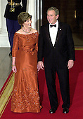 Washington, D.C. - November 2, 2005 -- United States President George W. Bush and first lady Laura Bush welcome Charles, the Prince of Wales and Camilla, the Duchess of Cornwall to the White House for a Social Dinner in their honor in Washington, D.C. on November 2, 2005. .Credit: Ron Sachs / CNP.(Restriction: No New York Metro or other Newspapers within a 75 mile radius of New York City)