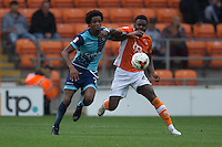Sido Jombati of Wycombe Wanderers battles with Bright Osayi-Samuel of Blackpool during the Sky Bet League 2 match between Blackpool and Wycombe Wanderers at Bloomfield Road, Blackpool, England on 20 August 2016. Photo by James Williamson / PRiME Media Images.
