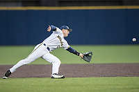 Michigan Wolverines second baseman Jimmy Kerr (15) dives for a line drive against the Michigan State Spartans on May 19, 2017 at Ray Fisher Stadium in Ann Arbor, Michigan. Michigan defeated Michigan State 11-6. (Andrew Woolley/Four Seam Images)