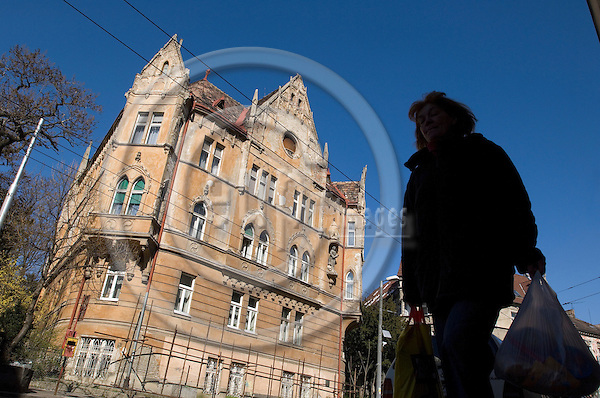 """BRATISLAVA - SLOVAKIA 11. MARCH 2007 -- In a Residential area in Bratislava. A woman carrying plastic bags passes an old building  -- PHOTO: GORM K. GAARE / EUP & IMAGES..This image is delivered according to terms set out in """"Terms - Prices & Terms"""". (Please see www.eup-images.com for more details)"""