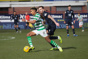 17th March 2019, Dens Park, Dundee, Scotland; Ladbrokes Premiership football, Dundee versus Celtic; Scott Sinclair of Celtic goes past Martin Woods of Dundee