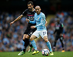 David Silva of Manchester City tussles with Luka Milivojevic of Crystal Palace during the premier league match at the Etihad Stadium, Manchester. Picture date 22nd September 2017. Picture credit should read: Simon Bellis/Sportimage