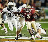 EVADING CAPTURE.  Florida State's Leon Washington tries to evade the grasp of Penn State defenders during the first half of the 2006 FedEx Orange Bowl Game.  Washington carried six times for 30 yards.