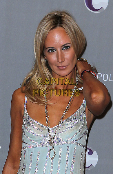 LADY VICTORIA HERVEY .New Year's Eve Grand Opening of the Cosmopolitan of Las Vegas, Las Vegas, Nevada, USA, 31st December 2010..half length tanned silver necklace beaded hand touching hair arm diamante green dress .CAP/ADM/MJT.© MJT/AdMedia/Capital Pictures.