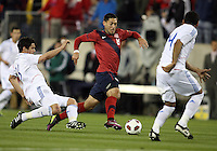 Clint Dempsey(8) of the USA MNT slips between Marcos Riveros(16) and Paulo Cesar Da Silva(14) of Paraguay during an international friendly match at LP Field, in Nashville, TN. on March 29, 2011. Paraguay won 1-0.